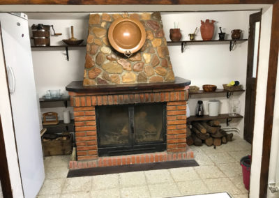 Rural House Los Cipreses de Mesones Guadalajara next to Madrid - Photo of the kitchen fireplace